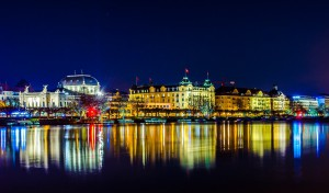 night view of skyline of the swiss city zurich reflecting on the zurich lake